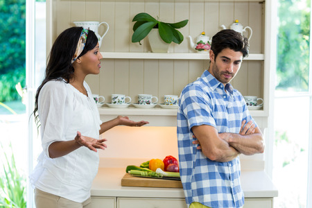 argument: Young couple into an argument in the kitchen