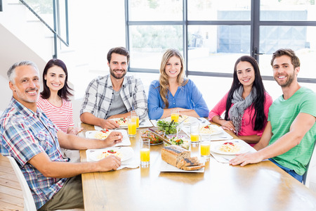 dining room: Family having a lunch and smiling at home