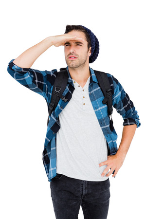 shielding: Young man shielding eyes on white background