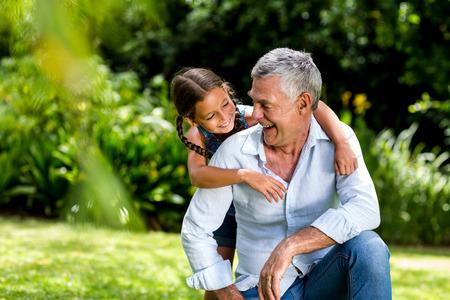 grandaughter: Happy grandfather and grandaughter playing at yard