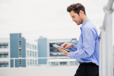 Businessman using digital tablet on office terrace Stock Photo