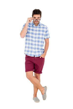 looking over: Handsome man looking over his spectacles on white background Stock Photo