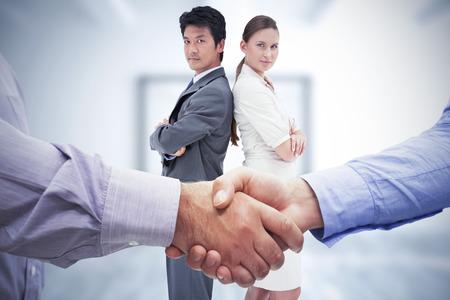 men shaking hands: Composite image of men shaking hands