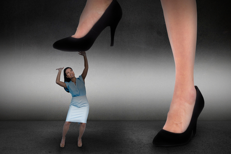 stepping on: Businesswoman stepping against black wall