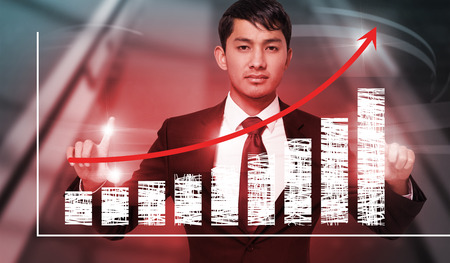 unsmiling: Unsmiling businessman holding against red arrow