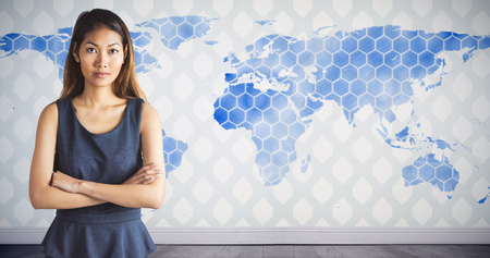 Businesswoman with crossed arms against background with world map
