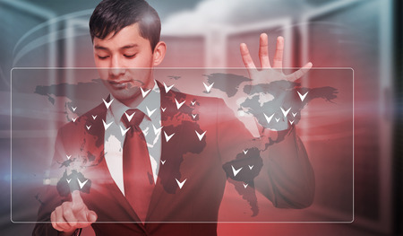 unsmiling: Unsmiling businessman holding and pointing against composite image of server room