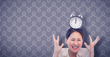 against the clock: Midnight time on clock against background Stock Photo
