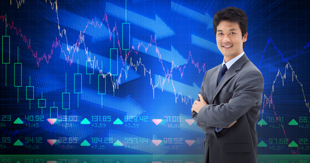 finance manager: Portrait of a smiling businessman with the arms crossed against stocks and shares