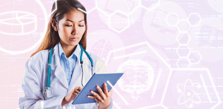 using tablet: Asian doctor using tablet against medical icons