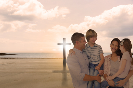 carrying the cross: Mother and father carrying children over white background against cross religion symbol shape over sunset sky at the beach