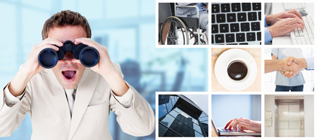 using binoculars: Positive businessman using binoculars against board room Stock Photo