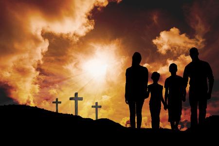 son of god: Portrait of happy family walking over white background against cross religion symbol shape over sunset sky