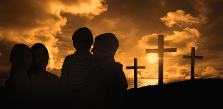 carrying the cross: Mother and father carrying children over white background against cross religion symbol shape over sunset sky