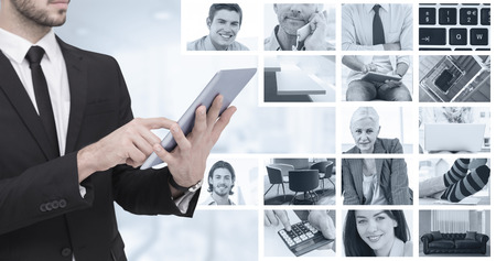 figuring: Mid section of a businessman using digital tablet pc against composite image of businessmen using laptop