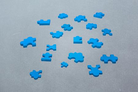 vignette: jigsaw pieces against grey vignette Stock Photo
