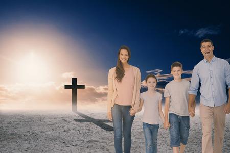 Portrait of happy family walking over white background against cross religion symbol shape over sky