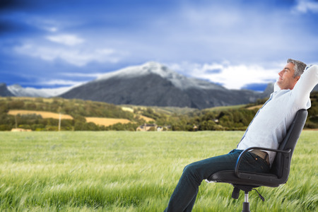 asleep chair: Side view of man sleeping on chair against scenic backdrop