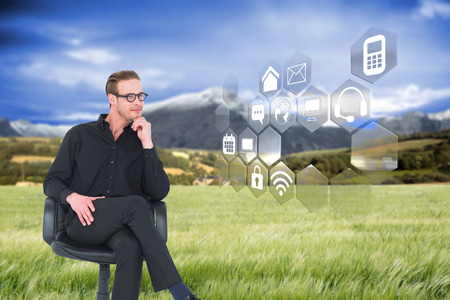 swivel chair: Thoughtful businessman sitting on a swivel chair against scenic backdrop Stock Photo