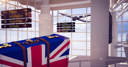 great britain flag: Great Britain flag suitcase against airport terminal