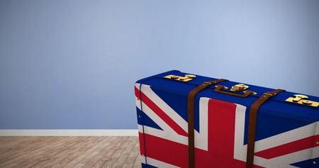 great britain flag: Great Britain flag suitcase against room with wooden floor