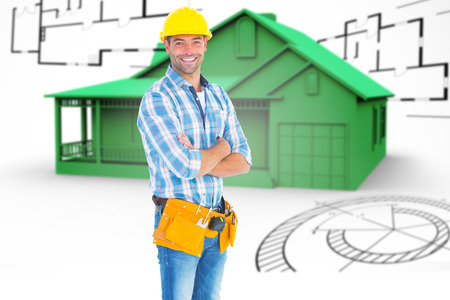 mid distance: Portrait of manual worker standing arms crossed against house in grey with architect plans
