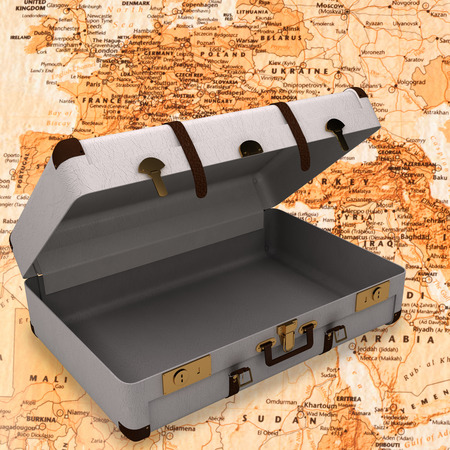 magnetic field: Open suitcase against world map with compass showing north africa and europe
