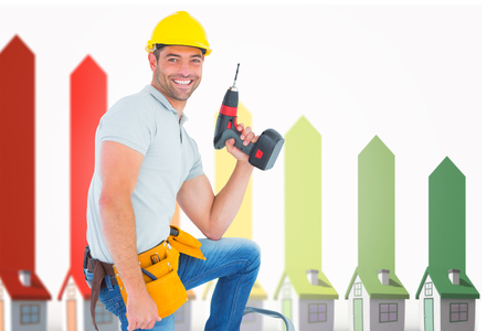 power drill: Confident handyman holding power drill while climbing ladder against seven 3d houses representing energy efficiency Stock Photo