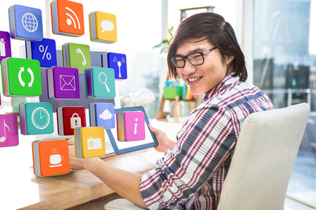 using tablet: Hipster businessman using tablet  against apps Stock Photo
