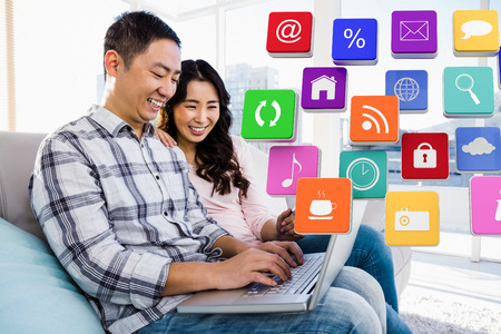 Apps against young couple using laptop