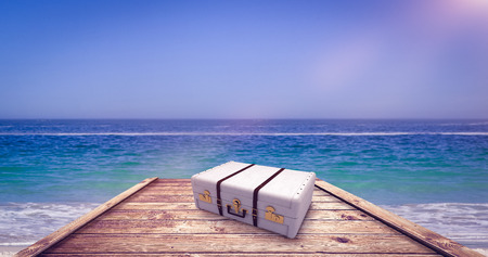 waters edge: Suitcase against waters edge at the beach