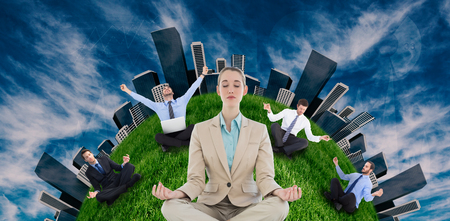 lotus position: Businesswoman sitting in lotus position against view of the blue sky