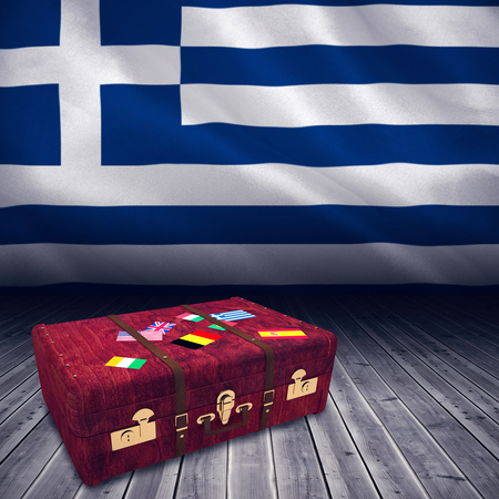 digitally: Suitcase with stickers against digitally generated greek national flag