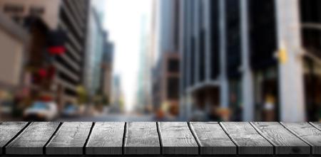 Wooden desk against new york street Stock Photo