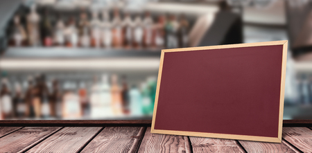 rack arrangement: Wine glasses suspended on a rack against bottle shelf against chalkboard