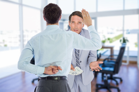 crossing fingers: Businessman crossing fingers behind his back against board room Stock Photo