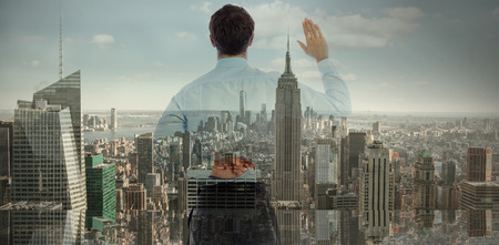 crossing fingers: Businessman crossing fingers behind his back against city skyline Stock Photo