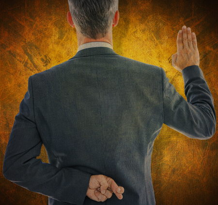 an oath: Rear view of businessman taking oath with fingers crossed against dark background
