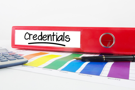 credentials: Word credentials underlined against business desk with documents Stock Photo