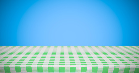 white and green tablecloth against blue background Stock Photo