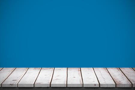 royal blue: Wooden table against royal blue