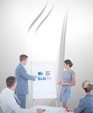business graphics: Manager presenting statistics to his colleagues against abstract white design Stock Photo