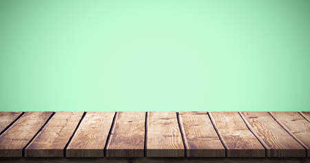 green background: Wooden table against green background Stock Photo