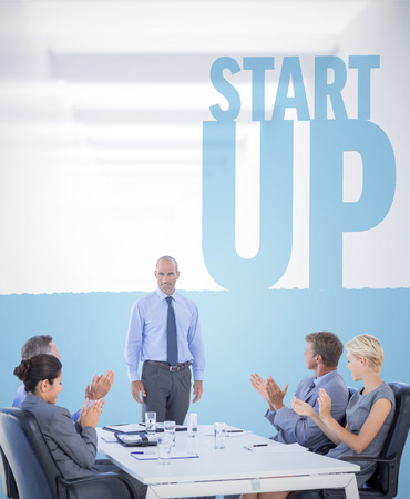 acclamation: Business people applauding during meeting  against start up Stock Photo