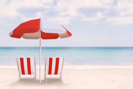 waters edge: Image of sun lounger and sunshade against waters edge at the beach