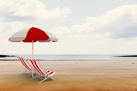 lounger: Image of sun lounger and sunshade against beach