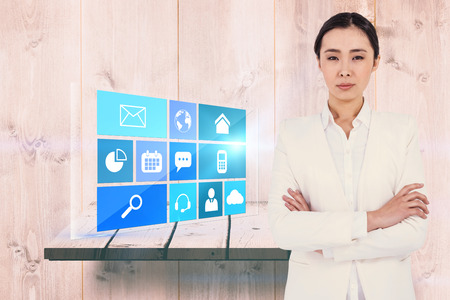 wooden shelf: Serious businesswoman with crossed arms against wooden shelf Stock Photo