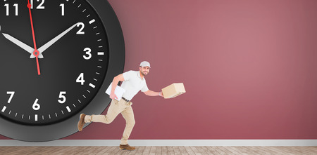 delivery room: Delivery man with cardboard boxes running in front of clock on a pink room