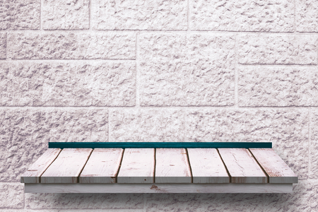 the shelf: Wooden shelf against stone wall