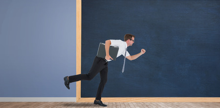 Running businessman in front of a chalkboard